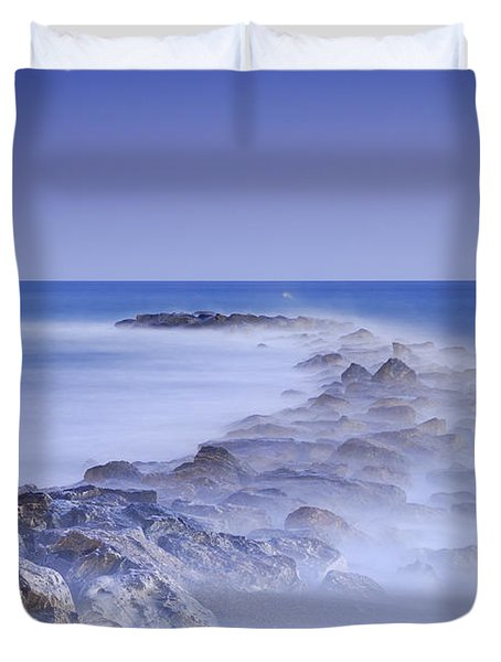 Rocks fighting against the waves Duvet Cover by Guido Montanes Castillo