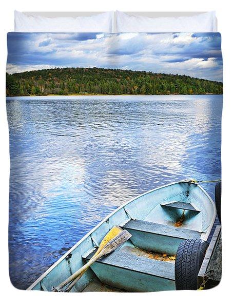 Rowboat docked on lake Duvet Cover by Elena Elisseeva