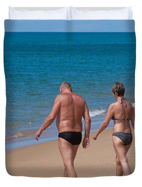 senior elderly  lover couple Duvet Cover by ATIKETTA SANGASAENG