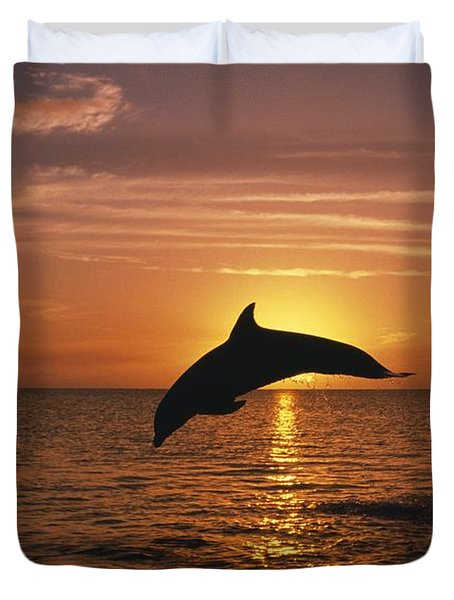 Silhouette Of Leaping Bottlenose Duvet Cover by Natural Selection Craig Tuttle