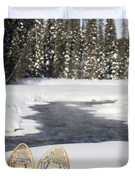 Snowshoes By Snowy Lake Lake Louise Duvet Cover by Michael Interisano