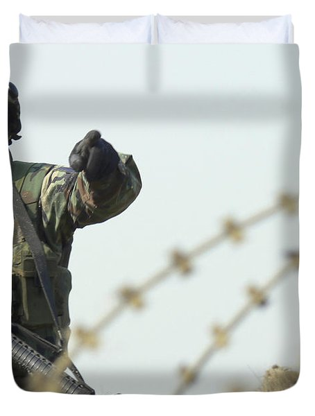 Soldier Calls Out Approaching Locals Duvet Cover by Stocktrek Images