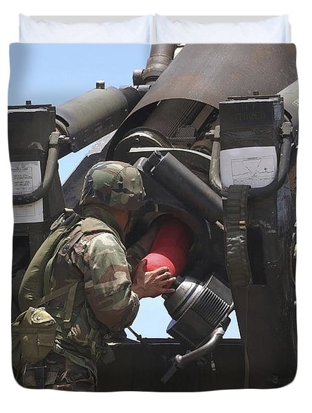 Soldier Loads A Charge Round Duvet Cover by Stocktrek Images