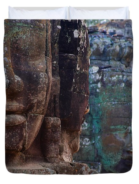 Stone Heads At Bayon Temple Duvet Cover by Carson Ganci