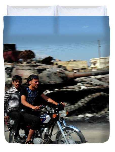 Syrian Men Drive A Motorbike Duvet Cover by Andrew Chittock