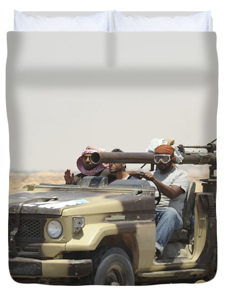 Three Rebel Fighters In A 4x4 Duvet Cover by Andrew Chittock
