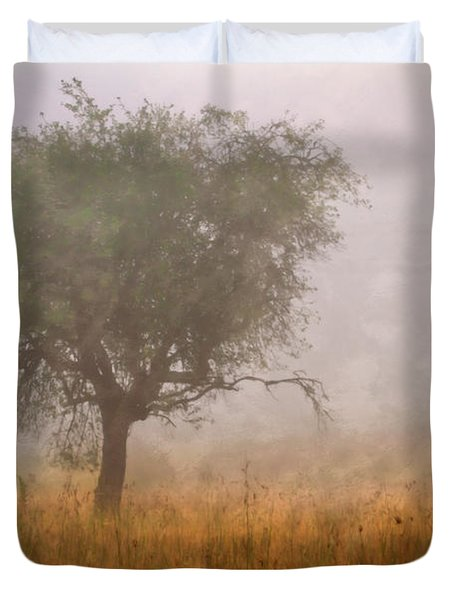 Tree In Fog Duvet Cover by Debra and Dave Vanderlaan