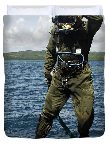 U.s. Navy Diver Jumps Off A Dive Duvet Cover by Stocktrek Images