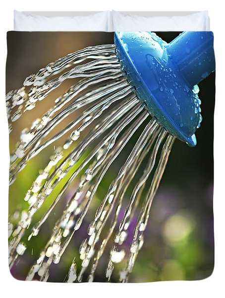 Watering flowers Duvet Cover by Elena Elisseeva