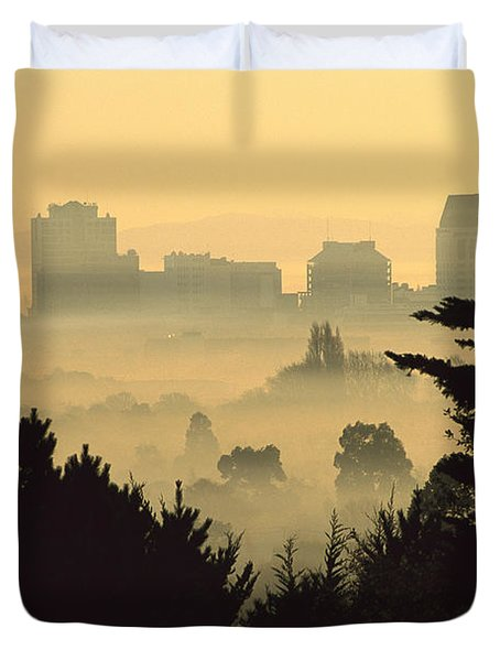 Winter Smog Over The City Duvet Cover by Colin Monteath