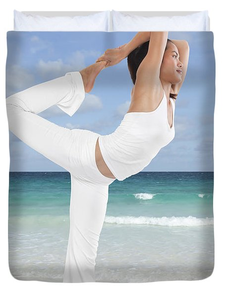 Woman doing yoga on the beach Duvet Cover by Setsiri Silapasuwanchai