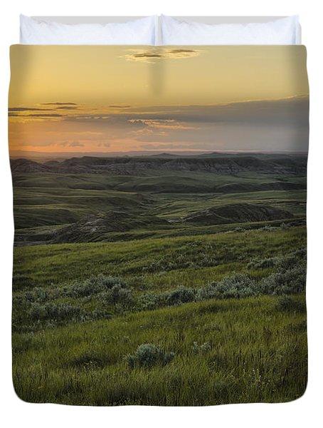 Sunset Over Killdeer Badlands Duvet Cover by Robert Postma