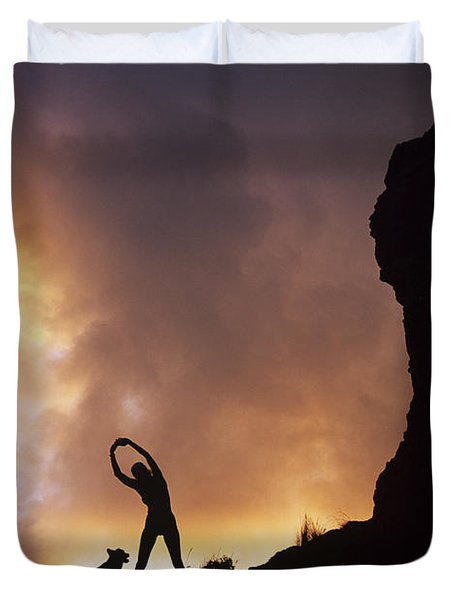 Woman Stretching On A Mountain Duvet Cover by Dana Edmunds - Printscapes