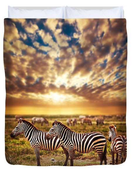 Zebras Herd On African Savanna At Sunset. Duvet Cover by Michal Bednarek
