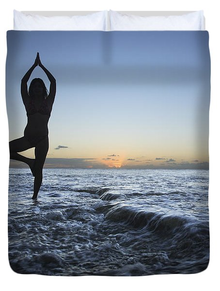 Female doing Yoga at sunset Duvet Cover by Brandon Tabiolo - Printscapes