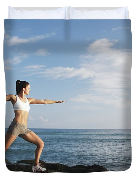 Female doing Yoga Duvet Cover by Brandon Tabiolo - Printscapes