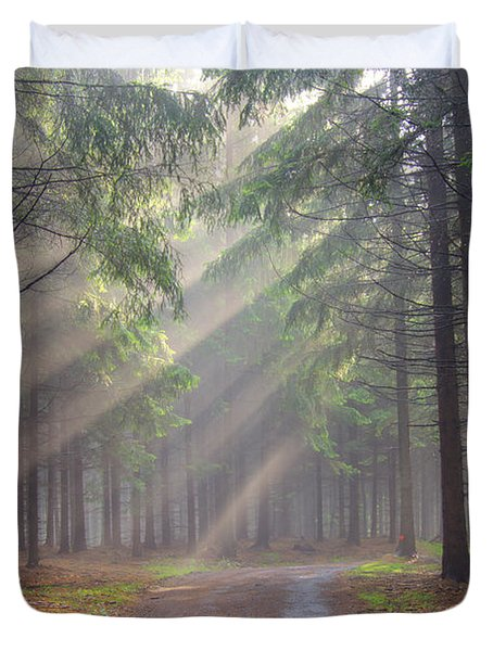God beams - coniferous forest in fog Duvet Cover by Michal Boubin