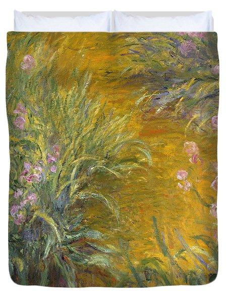 The Path Through The Irises Duvet Cover by Claude Monet