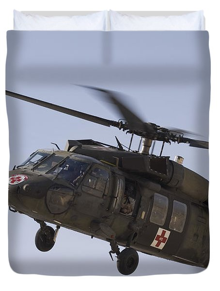 A Uh-60 Blackhawk Medivac Helicopter Duvet Cover by Terry Moore
