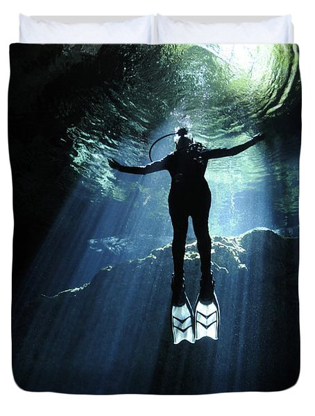 A Cavern Diver Ascends In The Cenote Duvet Cover by Karen Doody