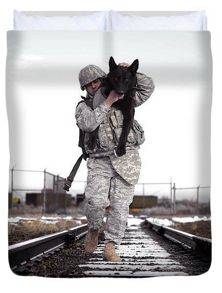 A Military Dog Handler Uses An Duvet Cover by Stocktrek Images