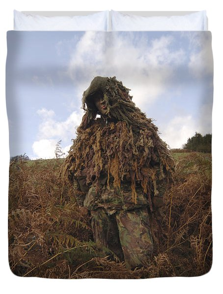A Sniper Dressed In A Ghillie Suit Duvet Cover by Andrew Chittock