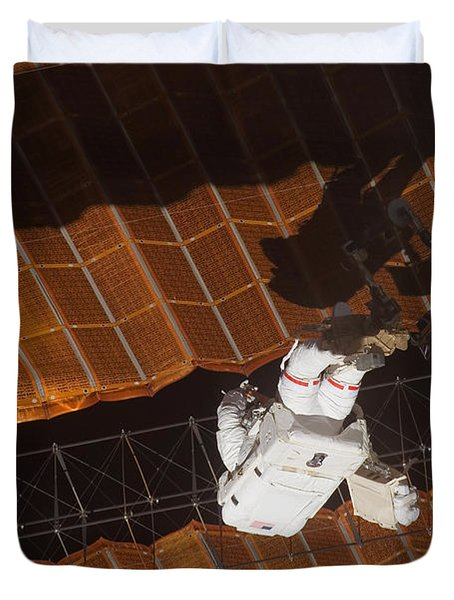 An Astronaut Anchored To A Foot Duvet Cover by Stocktrek Images