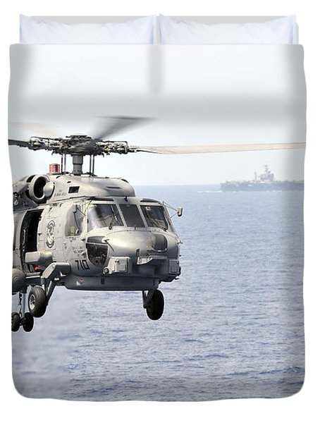 An Mh-60r Seahawk Helicopter In Flight Duvet Cover by Stocktrek Images