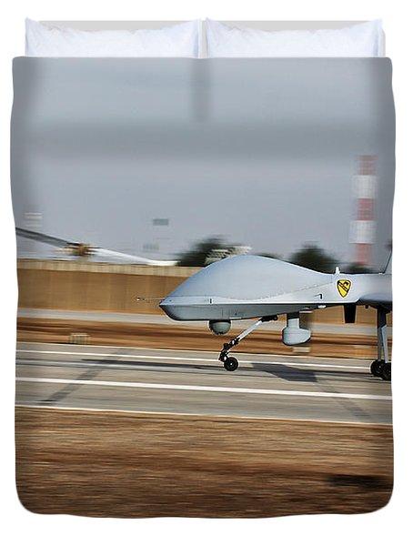 An Mq-1c Sky Warrior Uav Lands At Camp Duvet Cover by Stocktrek Images