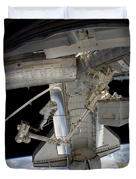 Astronaut Participates In A Spacewalk Duvet Cover by Stocktrek Images