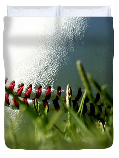 Baseball in Grass Duvet Cover by Chris Brannen