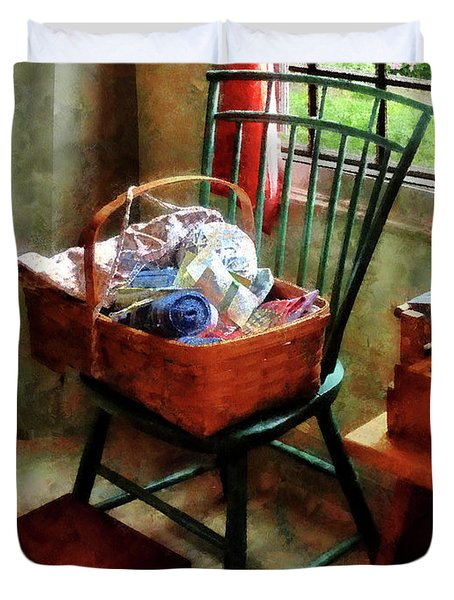 Basket Of Cloth And Yarn On Chair Duvet Cover by Susan Savad