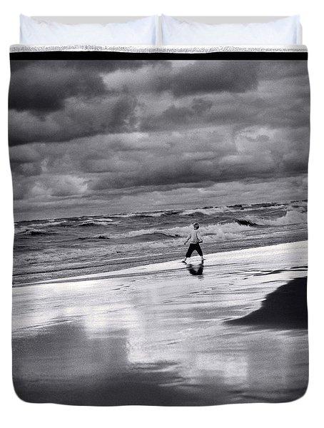 Boy On Shoreline Duvet Cover by Steve Gadomski