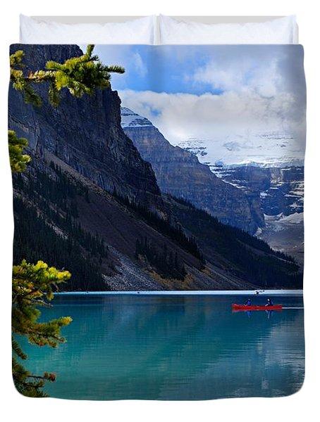 Canoe On Lake Louise Duvet Cover by Larry Ricker
