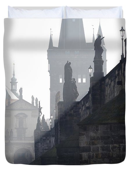 Charles bridge in the early morning fog Duvet Cover by Michal Boubin