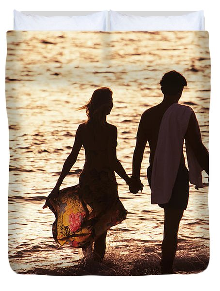 Couple Wading In Ocean Duvet Cover by Larry Dale Gordon - Printscapes