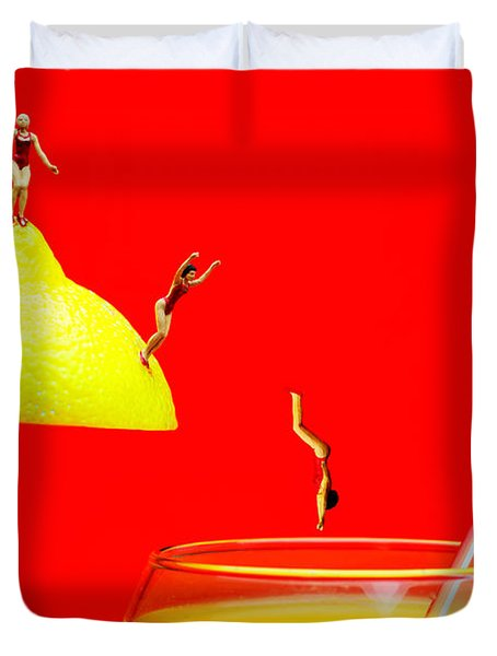 Diving Into Orange Juice Duvet Cover by Paul Ge