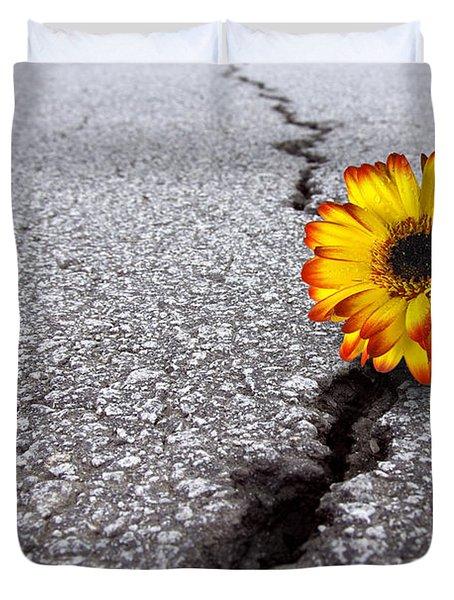Flower In Asphalt Duvet Cover by Carlos Caetano