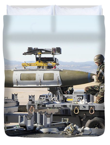 Irman Assists In Lowering A Guided Bomb Duvet Cover by Stocktrek Images