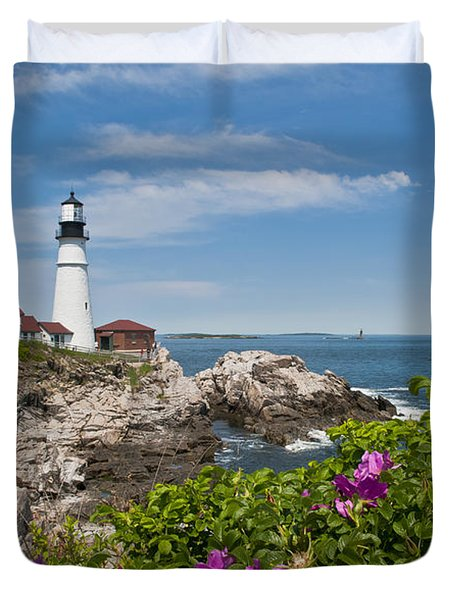Lighthouse With Rocks On Shore Duvet Cover by Bill Bachmann and Photo Researchers