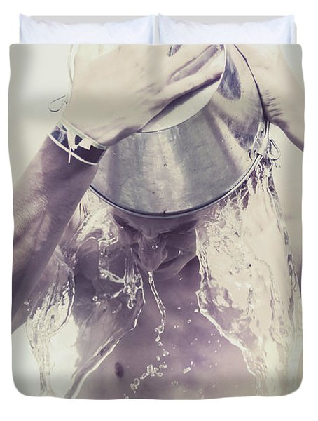 Man pouring cold water from wine cooler over body Duvet Cover by Ryan Jorgensen