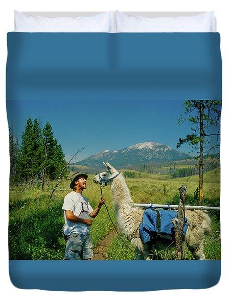 Man Teasing A Llama Duvet Cover by Jerry Voss