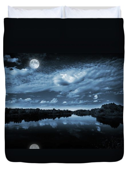 Moonlight over a lake Duvet Cover by Jaroslaw Grudzinski