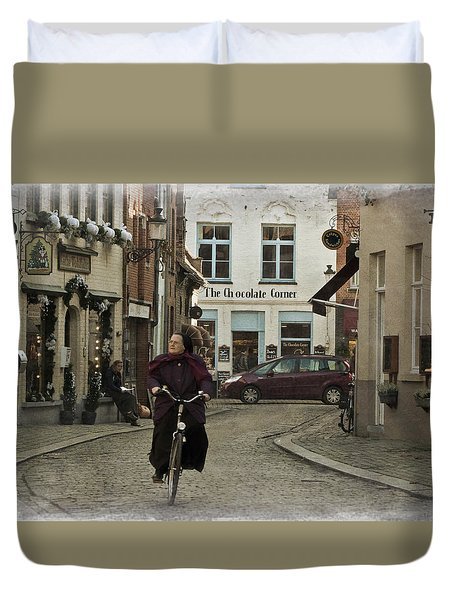 Nun On A Bicycle In Bruges Duvet Cover by Joan Carroll