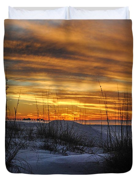 Orange Clouded Sunrise over the Pier Duvet Cover by Michael Thomas