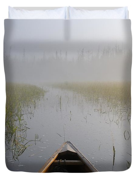Paddling Into The Fog Duvet Cover by Larry Ricker