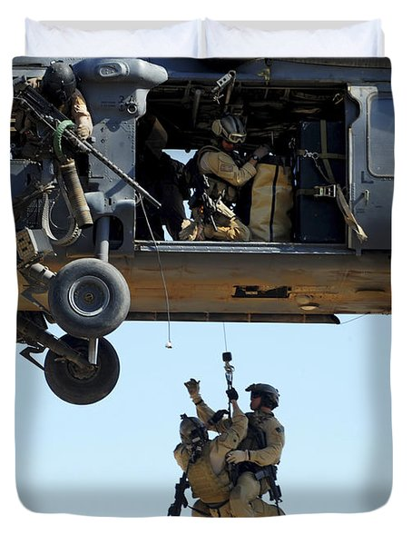 Pararescuemen Are Hoisted Into An Hh-60 Duvet Cover by Stocktrek Images