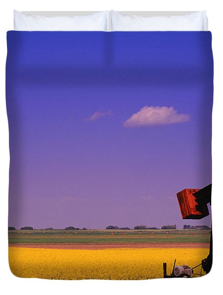Pumpjack In A Canola Field Duvet Cover by Carson Ganci