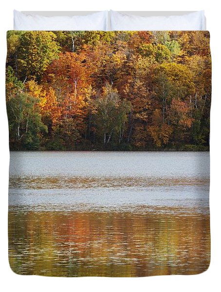 Reflection Of Autumn Colors In A Lake Duvet Cover by Susan Dykstra