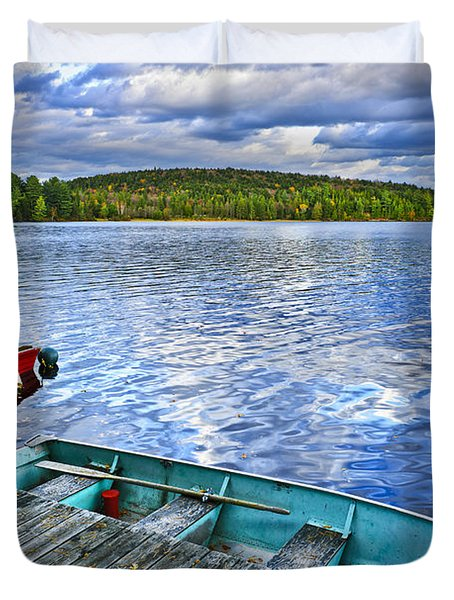 Rowboats on lake at dusk Duvet Cover by Elena Elisseeva